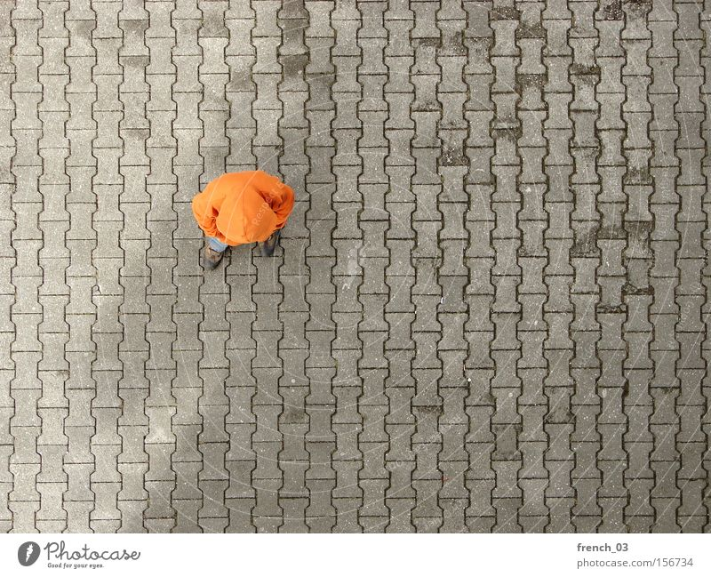 fading shadow Human being 1 Places Traffic infrastructure Clothing Sweater Stone Concrete Line Stand Wait Gloomy Gray Boredom Colour Orange Hooded (clothing)