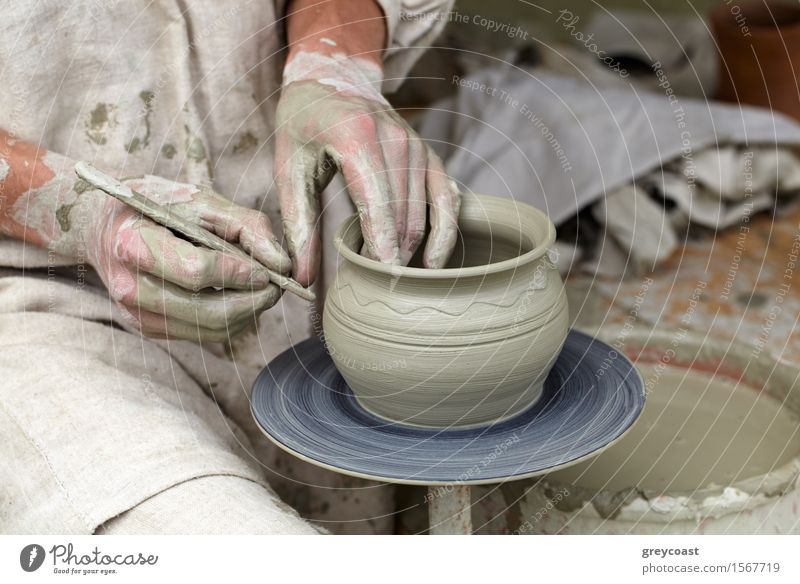 Potter's hands making a pot in a traditional style. Leisure and hobbies Work and employment Profession Human being Man Adults Hand 1 18 - 30 years