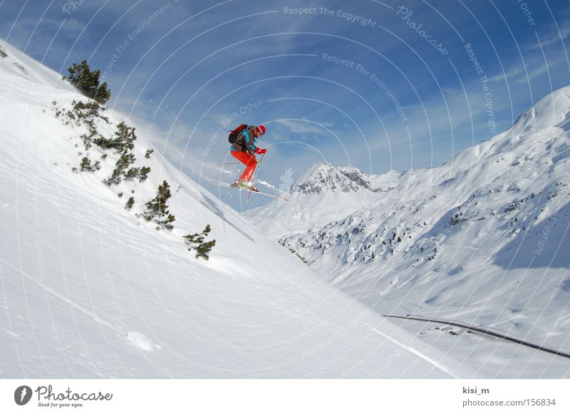Joy Sports Snow Jump Playing Mountain Skiing Skis Austria Blue sky Winter sports Federal State of Tyrol Deep snow Powder snow Ski pole Free skiing