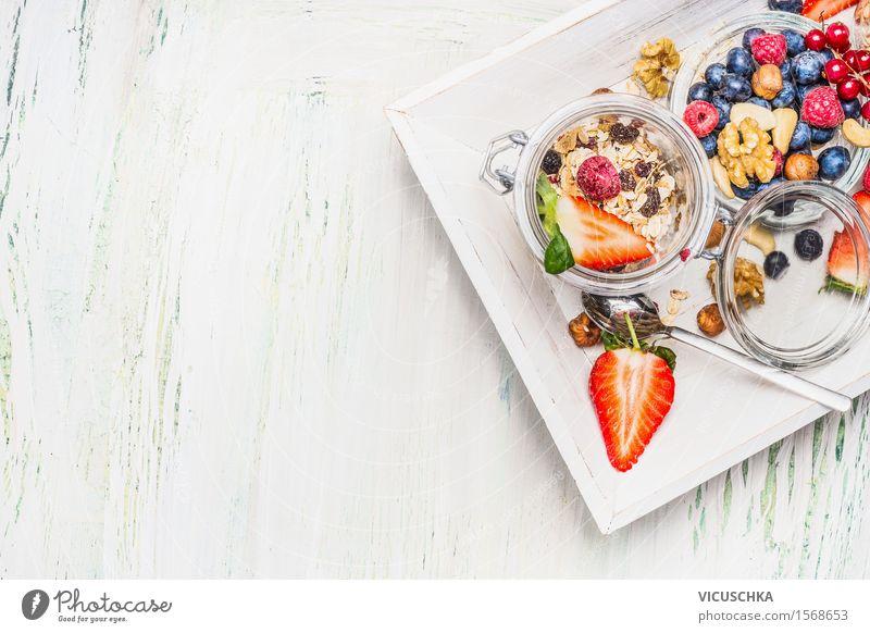 Healthy breakfast with muesli in a glass and berries Food Fruit Grain Dessert Nutrition Breakfast Buffet Brunch Organic produce Vegetarian diet Diet Glass Spoon
