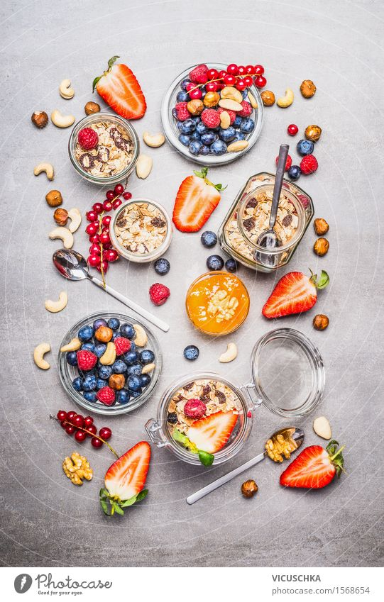 Muesli in a jar, fresh berries, seeds and nuts Food Fruit Grain Nutrition Breakfast Organic produce Vegetarian diet Diet Glass Spoon Design Healthy Eating Life