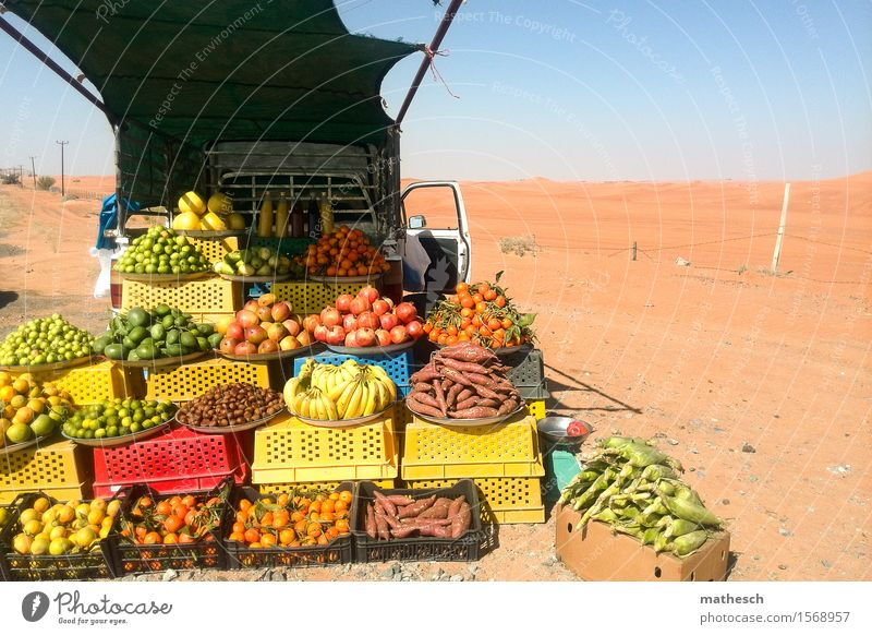 desert fruit Fruit Orange Mango Banana Sand Cloudless sky Desert Fresh Healthy Hot Delicious Sell Colour photo Exterior shot Deserted Copy Space right Day