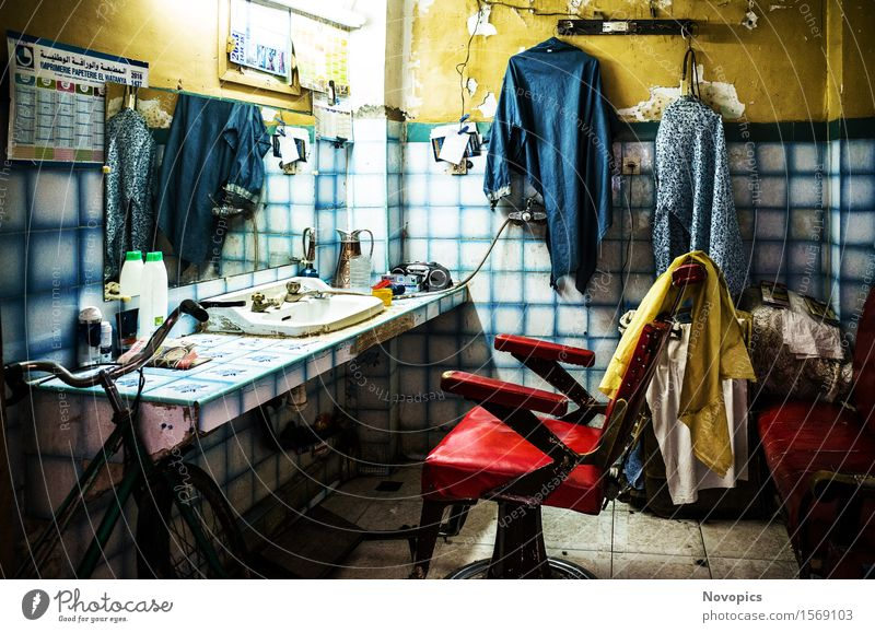 hair salon in Marrakech - Marocco Hair and hairstyles Living room Craftsperson Architecture Clothing Blue Yellow Red Still Life street photography Hairdresser
