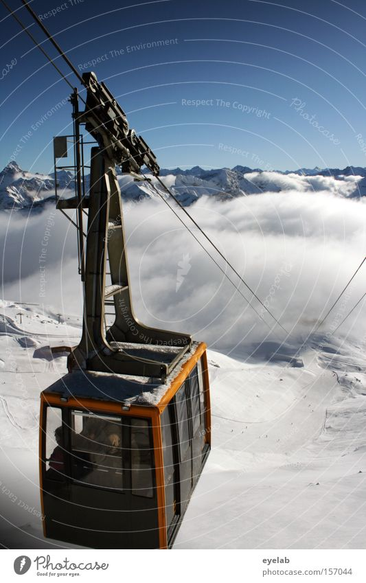 Gemma nauf...gemma widda nunder Cable car Mountain Winter Clouds Sky Peak Wire cable Rope Far-off places Vantage point Snow summit railway Winter vacation