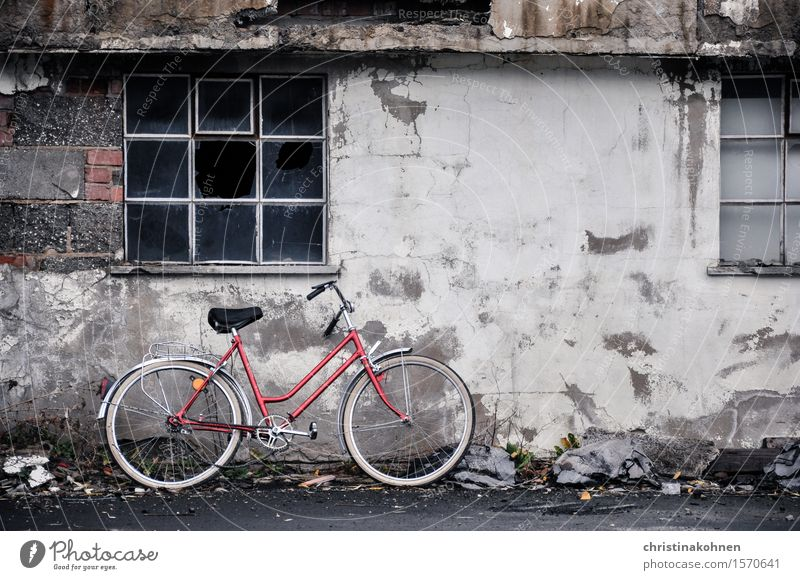 Red bike, grey wall. Trist and kaput. Bicycle Ladies' bicycle hollandrad Industrial plant Wall (barrier) Wall (building) Window Cycling Stone Concrete Glass