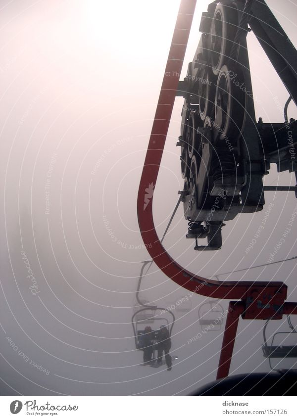 ...give me a lift! Chair lift Technology Clouds Human being Machinery Austrian Alps Mountain Ski resort Hanger Back-light Fog Winter Coil two-seater