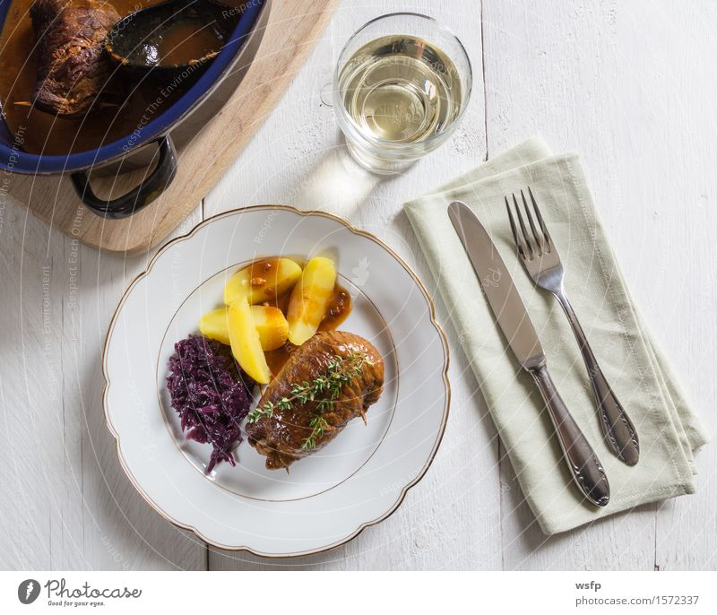 Beef roulades with potatoes and red cabbage Meat Authentic Beef olive Cattle Potatoes boiled potatoes Red cabbage Thyme Sauce main course White wooden table
