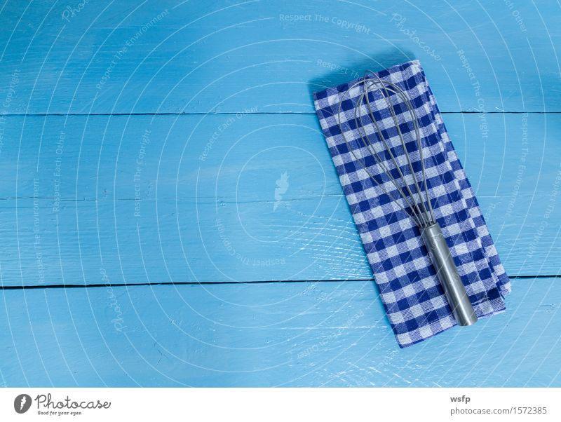 Whisk and tea towel on blue wood background Kitchen Restaurant Gastronomy Old Blue White Beater Dish towel kitchen towel Wooden board Wooden table Wooden sign
