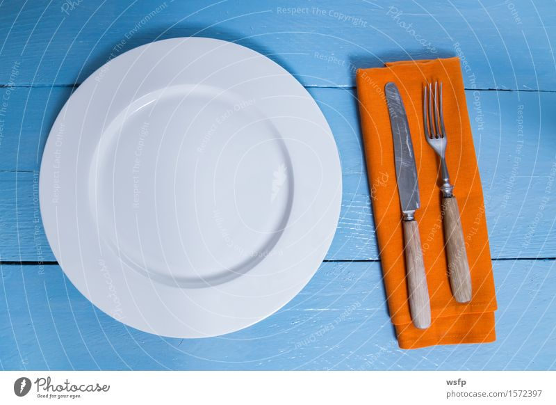 Cutlery and plate on blue wood background Plate Fork Kitchen Restaurant Gastronomy Old Blue Empty Napkin Knives Wooden board Orange Wooden table Wooden sign