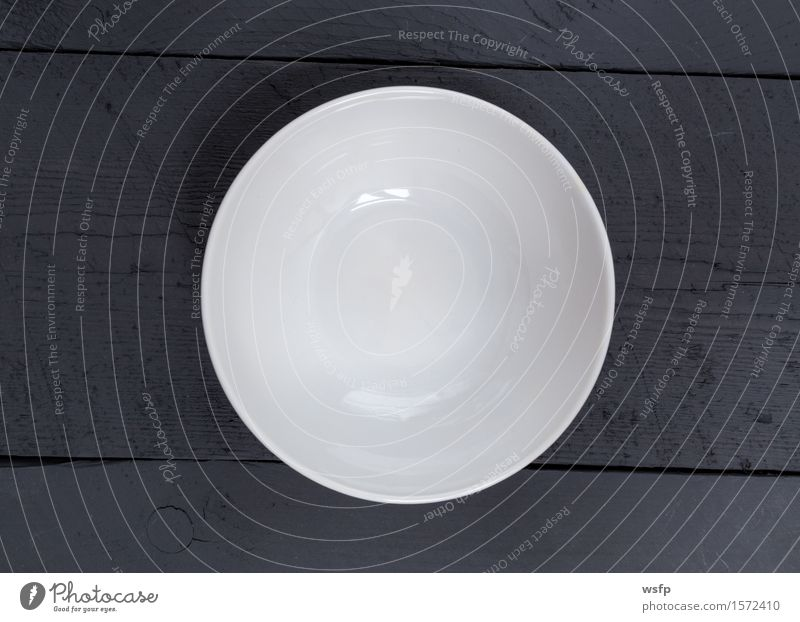 Empty bowl on black wood in bird's eye view Bowl Restaurant Gastronomy Old Black White shell Anthracite Wooden board Wooden table Wooden sign boards Menu