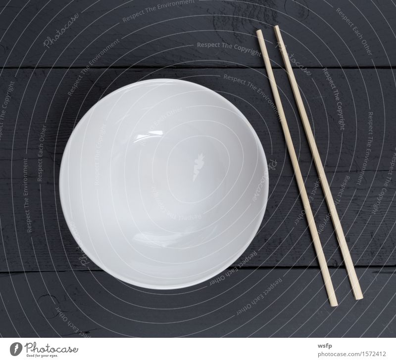 Bowl with sticks on black wood in bird's eye view Restaurant Gastronomy Old Black White shell Chopstick Anthracite Empty Wooden board Wooden table Wooden sign