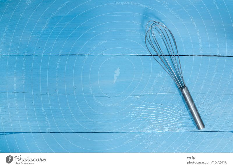 Whisk on blue wood as background Kitchen Restaurant Gastronomy Old Blue Beater Wooden board Wooden table Wooden sign wooden background boards Menu menu card