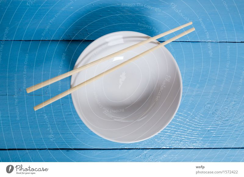 Bowl with sticks on blue wood in bird's eye view Restaurant Gastronomy Old Blue White shell Chopstick Empty Wooden board Wooden table Wooden sign boards Menu