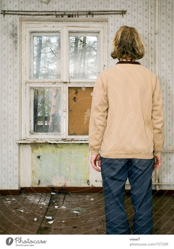 The melancholy of the moment Living room Stand Posture Earnest Flat (apartment) Wallpaper Calm Man Room Location Window Curtain Decline Derelict venues