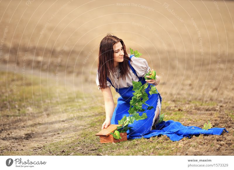 Young woman in spring countryside scenery Human being Nature Youth (Young adults) Blue Green Beautiful Summer White Landscape Leaf Joy 18 - 30 years Face Adults