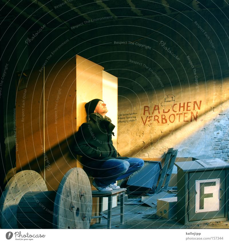 the non-smoker Man Human being Smoking No smoking Barn Small room Light Extinguisher Sun Sunbathing Derelict cable drum