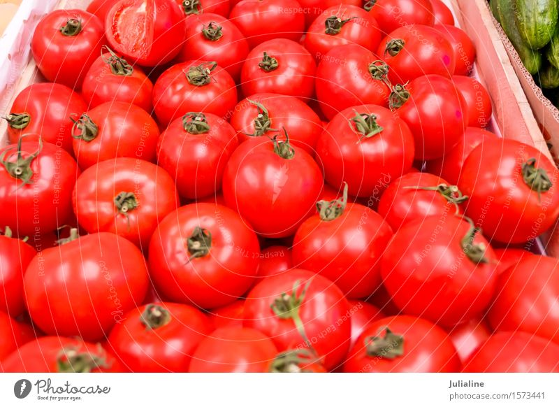 Background with fresh red tomatos Vegetable Vegetarian diet Fresh Yellow Red Tomato food healthy ripe Raw Organic Colour photo
