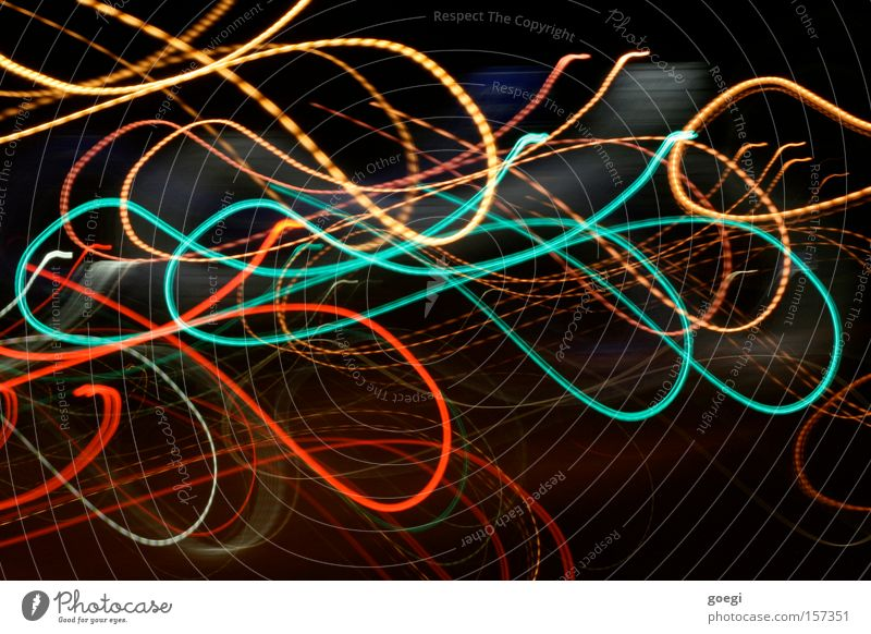 hullabaloo Colour photo Exterior shot Experimental Night Light Long exposure Motion blur Line Movement Yellow Green Red Sea of light Turquoise Wavy line