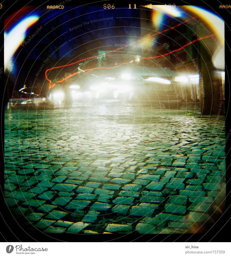 Monday morning in front of the school Lomography Transport Motor vehicle Cobblestones Street Light Long exposure Car Take a photo Art Car headlights Back-light