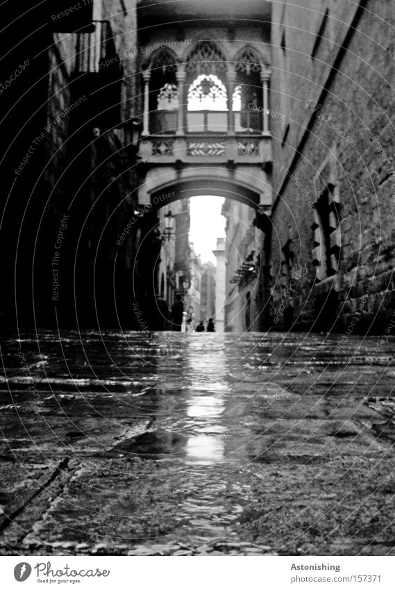Dark lane Alley Barcelona Spain Black & white photo Contrast Wet Town Gray Stone Street Old town Gate Traffic infrastructure
