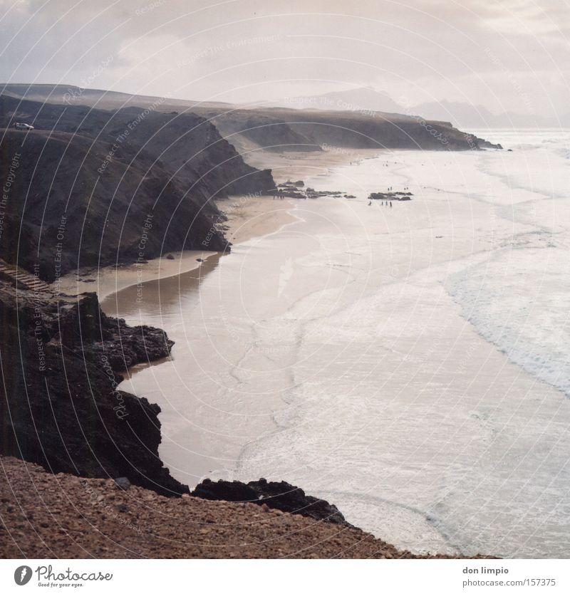 la pared Copy Space right Beach Ocean Waves Coast Wall (barrier) Wall (building) Stone Tall Atlantic Ocean Surfer Fuerteventura Medium format Analog