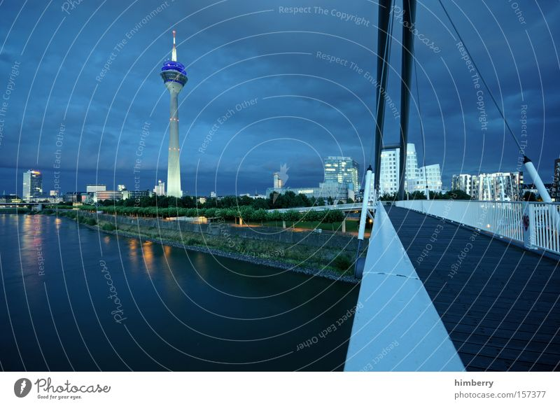 blue credit monday Moody Atmosphere Duesseldorf Town Night Night life River Bridge Lighting Reflection Television tower Tower Architecture Landmark Monument