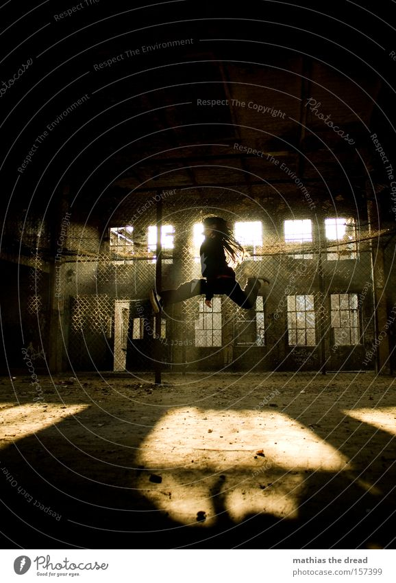 Man Old Sun Jump Flying Tall Aviation Action Factory Derelict Extreme sports Wire netting fence