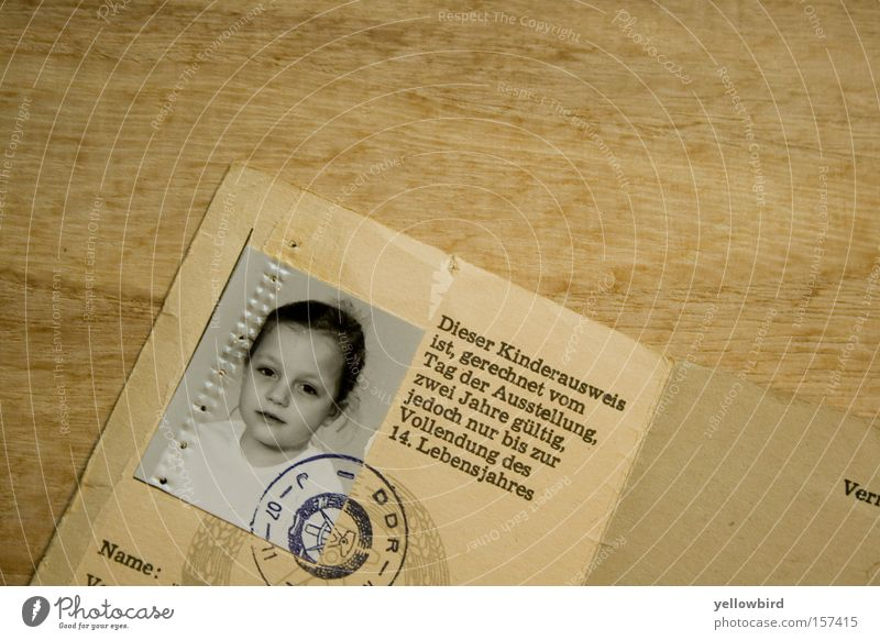 Back in the GDR. Child Authentic Historic Curiosity Cute Original Gloomy Feminine Brown Identification East Travel pass Passport photograph Photography child ID