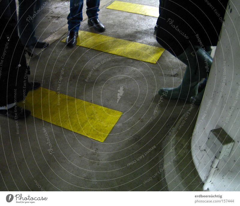 Human being Yellow Dark Group Gray Feet Legs Communicate Agree Discussion Zebra crossing Underground garage