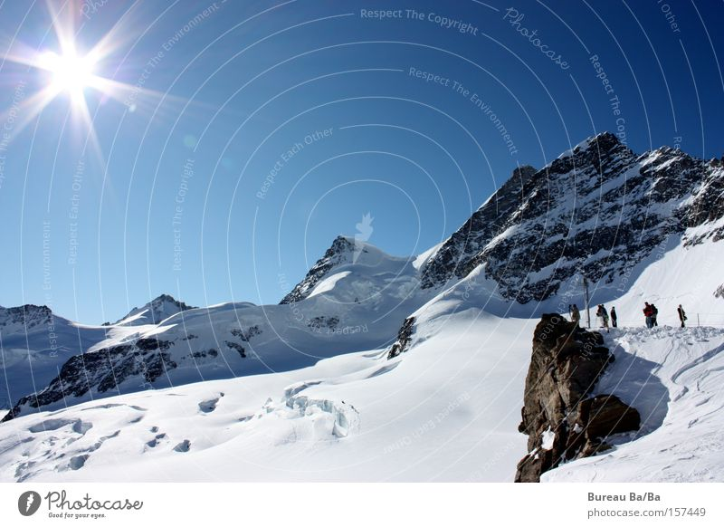 Sun Blue Snow Mountain Switzerland Peak Europe Tourist Monk (mountain) Jungfrau High mountain region Mountain hiking Eiger Snow layer Bernese Oberland