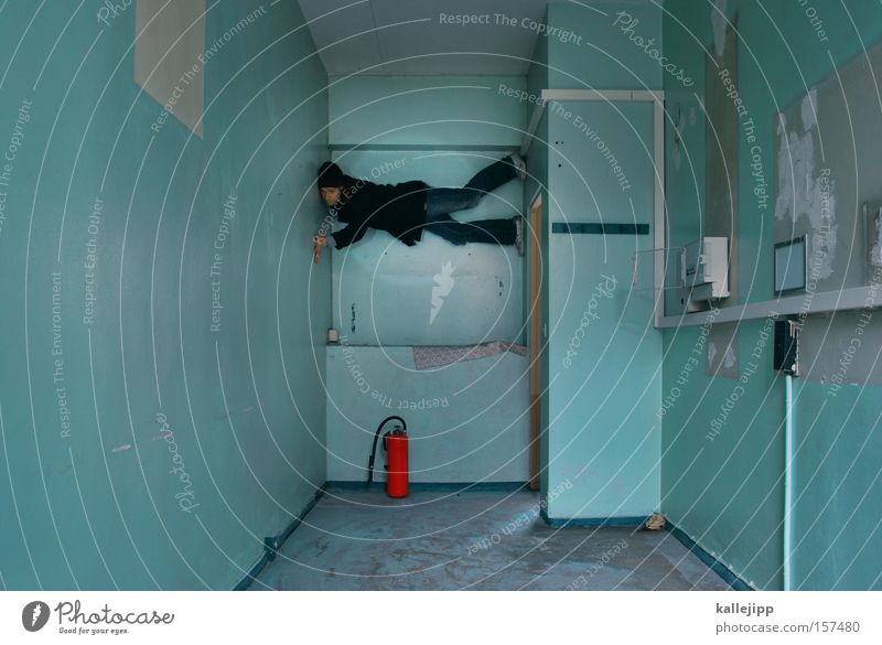 Human being Man Red Wall (building) Room Blaze Fire Dangerous Threat Climbing Fitness Furniture Turquoise Fire prevention Location Protection