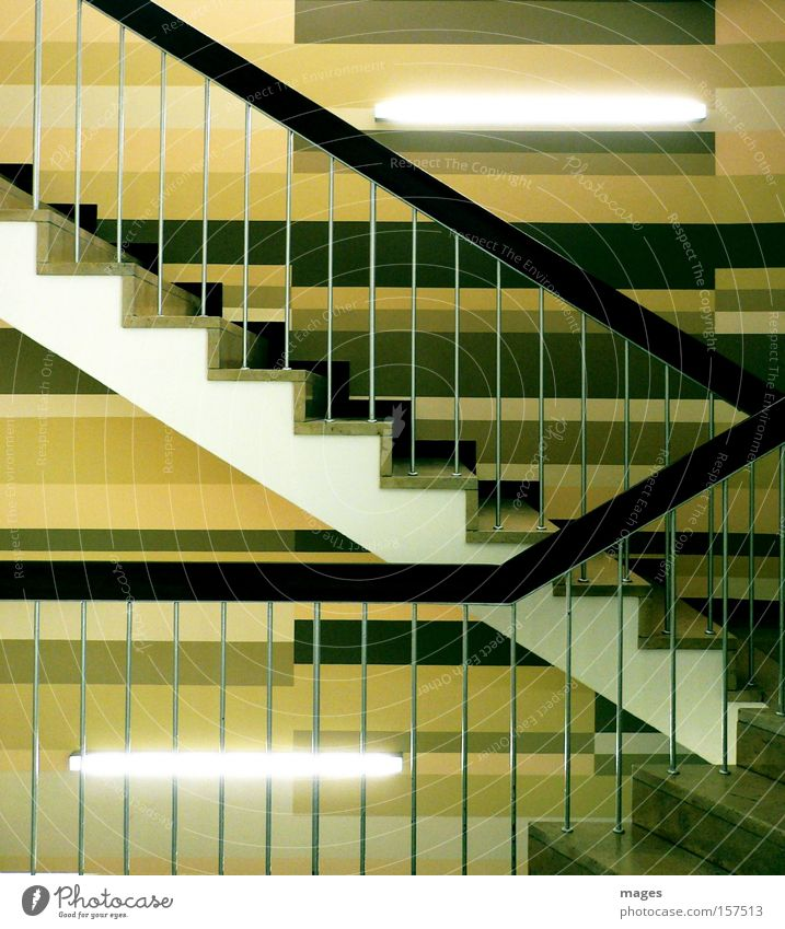 stairwell Stairs Level Handrail Banister Neon light Fluorescent Lights Zigzag Brown Line Upward Downward Entrance Detail Hallway wall design beige tones Tilt