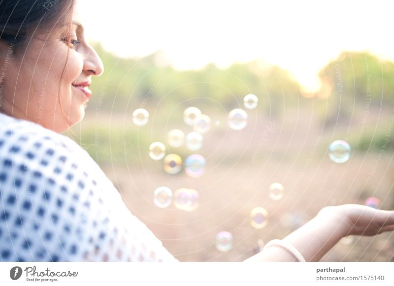 Woman with bubbles Human being Feminine Young woman Youth (Young adults) Adults Face 1 30 - 45 years Nature Air Sunrise Sunset Sunlight Summer Catch To enjoy