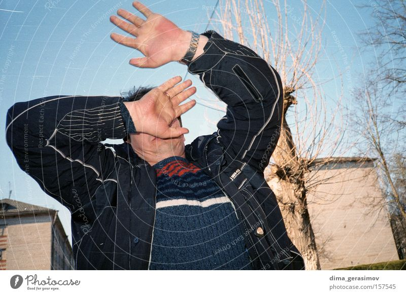 Man 1 Street Disappointment Tree Hand Russia Fight Argument Fear Panic Conflict Exterior shot