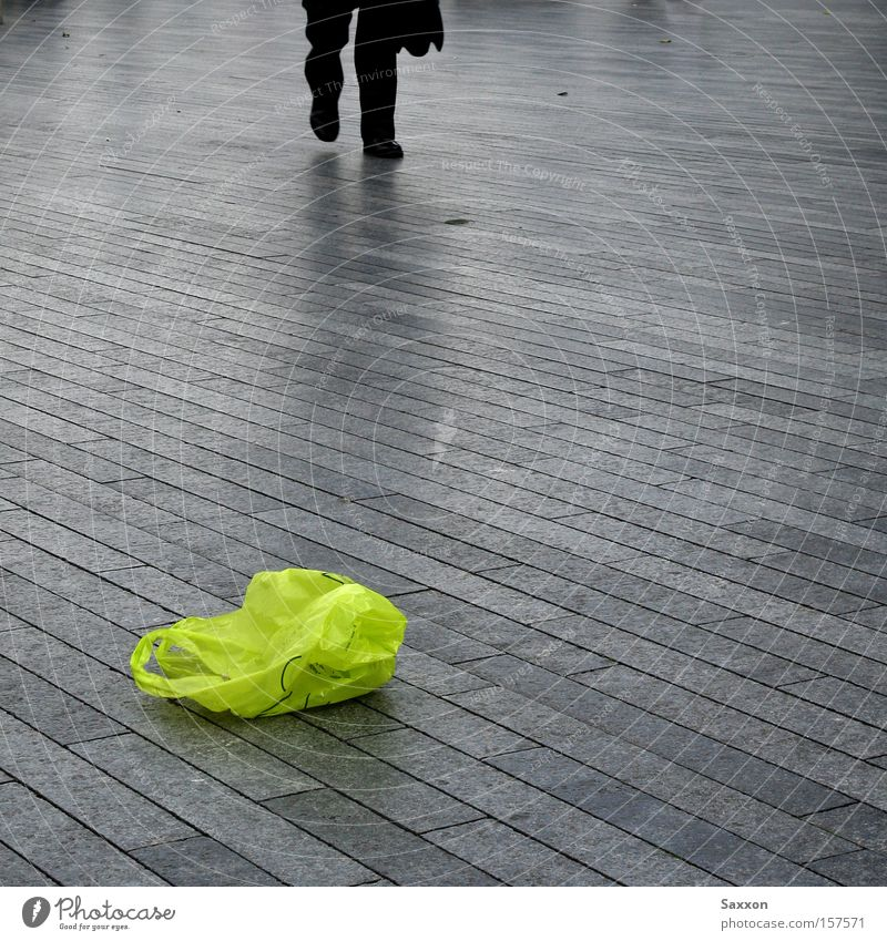 The green bag Promenade Sidewalk Footpath Green Paper bag Trash Recycling Commute Patch of colour Gloomy Loneliness Traffic infrastructure Paving stone Haste