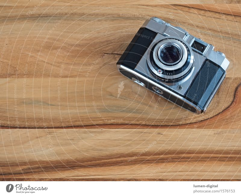 analogue 35mm camera on brown wooden table Camera Technology Old Retro Black Silver image Analog Appearance Ancient Equipment Background picture Aperture