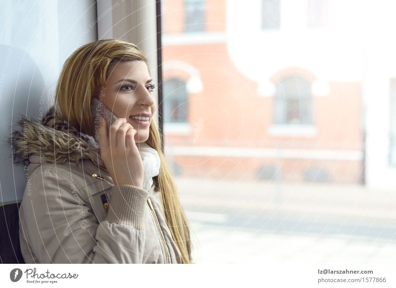 Blond woman talking on mobile phone Human being Woman Youth (Young adults) 18 - 30 years Face Adults To talk Transport Copy Space Smiling Railroad Telephone