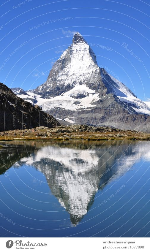 Matterhorn with mirror image Mountain Hiking Landscape Water Summer Beautiful weather Rock Alps Switzerland Peak Snowcapped peak Lake Mountain lake Nature
