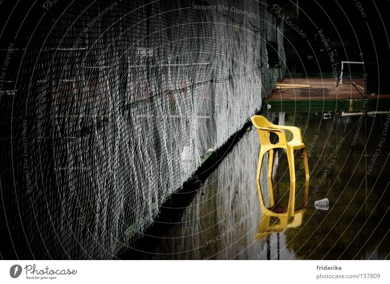 water sports II Chair Water Yellow Wire netting Fence Tennis court Reflection Mirror image Inundated Deluge Plastic chair Puddle Rainwater Break Game over
