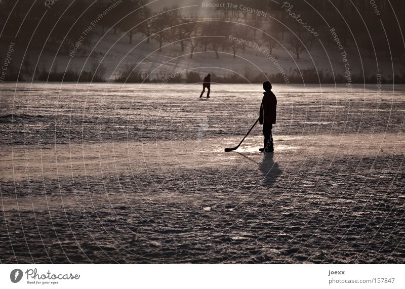 Child Winter Loneliness Boy (child) Playing Ice Frozen Winter sports Ice-skating Frozen surface Ice hockey Field hockey