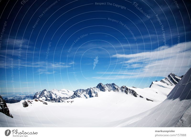 eternal snowfield Peak Mountain Alpine Clouds Cold Bernese Oberland Switzerland Snow virgin yoke Panorama (View) Snowcapped peak Blue sky Beautiful weather