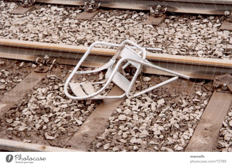 chair Railroad tracks Accident Sudden fall Tragedy Dangerous Fear Panic Chair capped Silver cafe chair