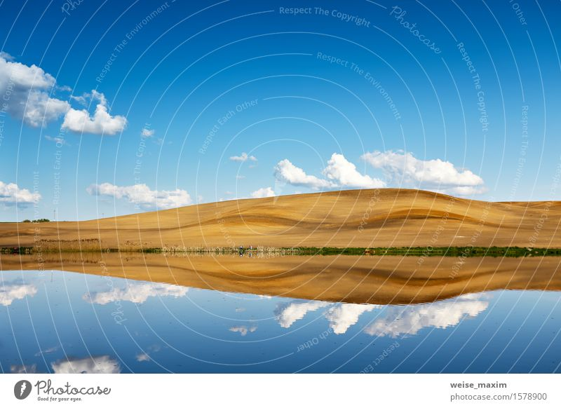 Fishing on a calm water. Hills and sky behind a lake Sky Nature Vacation & Travel Blue Beautiful Summer White Landscape Clouds Environment Yellow Spring Natural