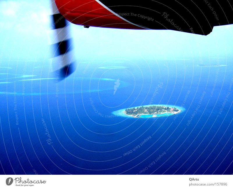 Vacation & Travel Ocean Flying Airplane Island Aviation Asia Exotic Maldives Reef Propeller Atoll Propeller aircraft Indian Ocean View from the airplane