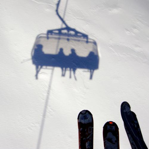 on the air Skiing Skis Snow Shadow White Chair lift Ski lift Human being Mountain Austria Ischgl Air Height Winter Winter sports Skilift chair Bright background