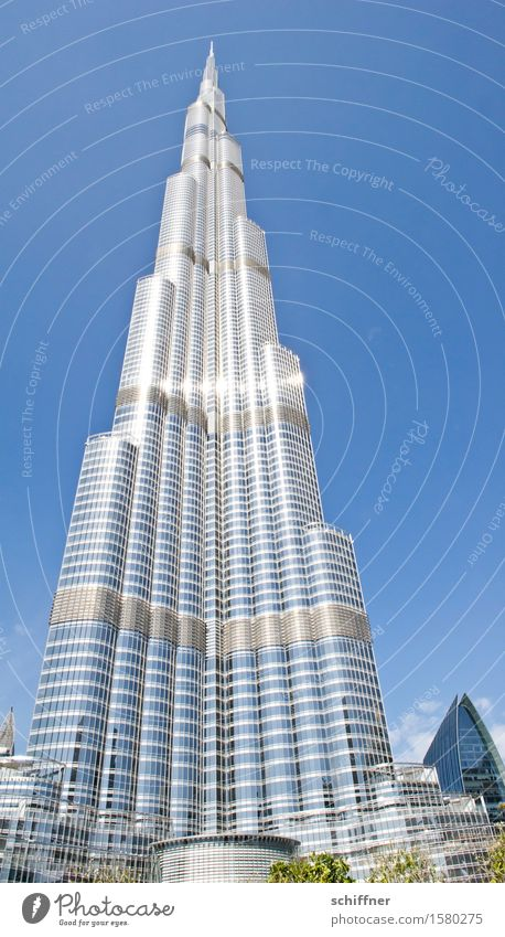 Babel again House (Residential Structure) High-rise Manmade structures Building Architecture Tourist Attraction Landmark Large Tall Blue Silver Burj Khalifa