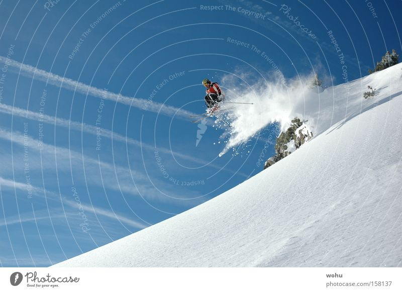 completely sown Skiing Skier Snow Snowfall Skis Jump Flying Mountain Winter sports Joy Freestyle Extreme Dynamics Air Trick Blue sky Aviation Energy industry