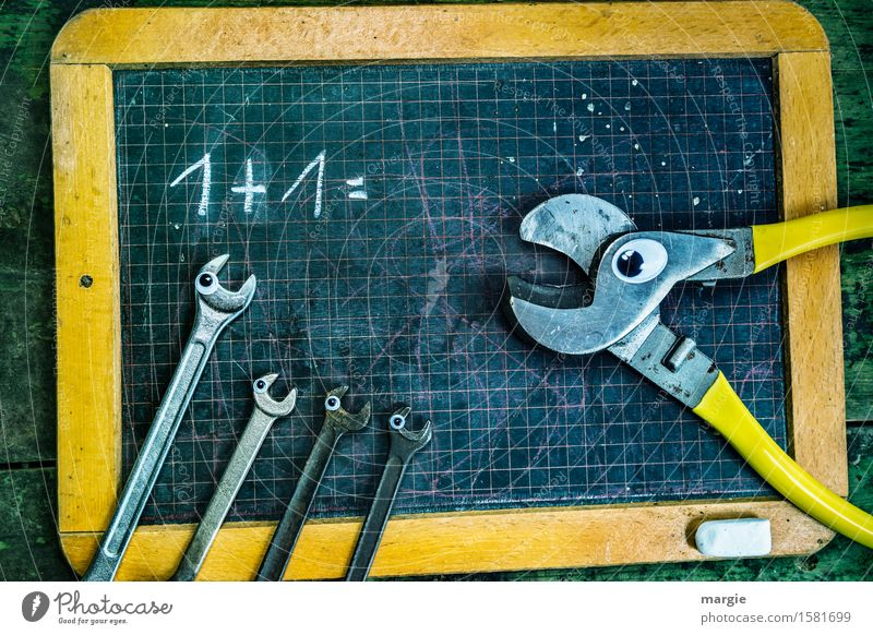 1 + 1 = ? A pair of pliers and four wrenches with eyes on an old calculating board School Blackboard Schoolchild Student Teacher Profession Craftsperson
