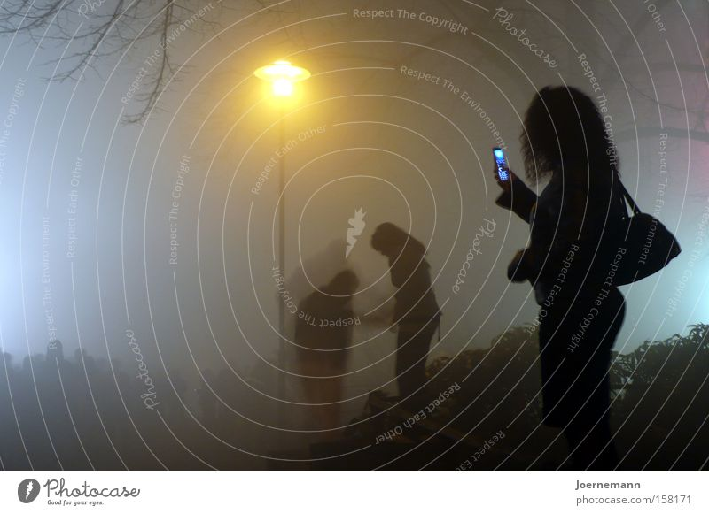 Human being Woman Youth (Young adults) City 18 - 30 years Adults Feminine Fog Stand Telephone Lantern Bottom Cellphone To talk To call someone (telephone)