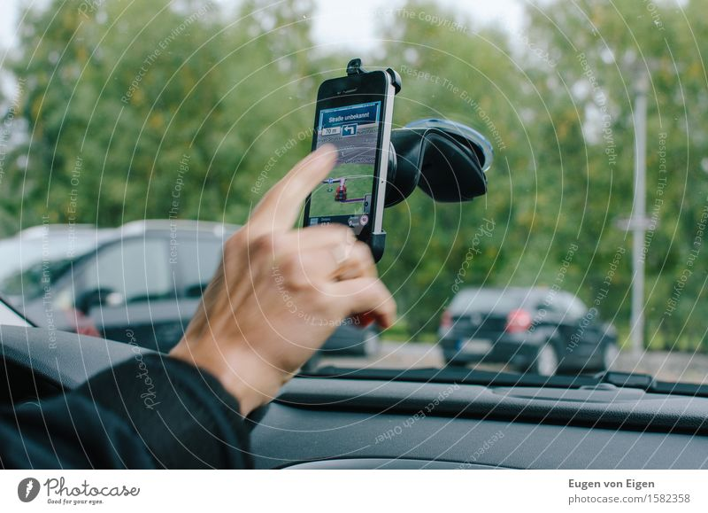 Mobile phone navigation in the car City trip Telephone Cellphone Human being Hand Fingers 1 Motoring Street Car Anticipation Serene Navigation Groundbreaking